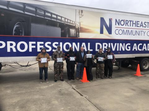 driver graduates in front of truck