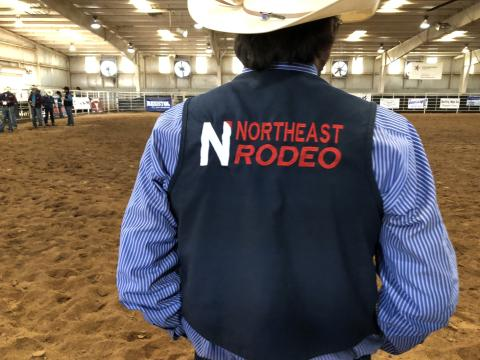 rodeo athlete wearing logo vest