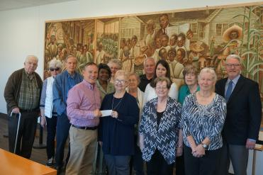 Retired teachers present check